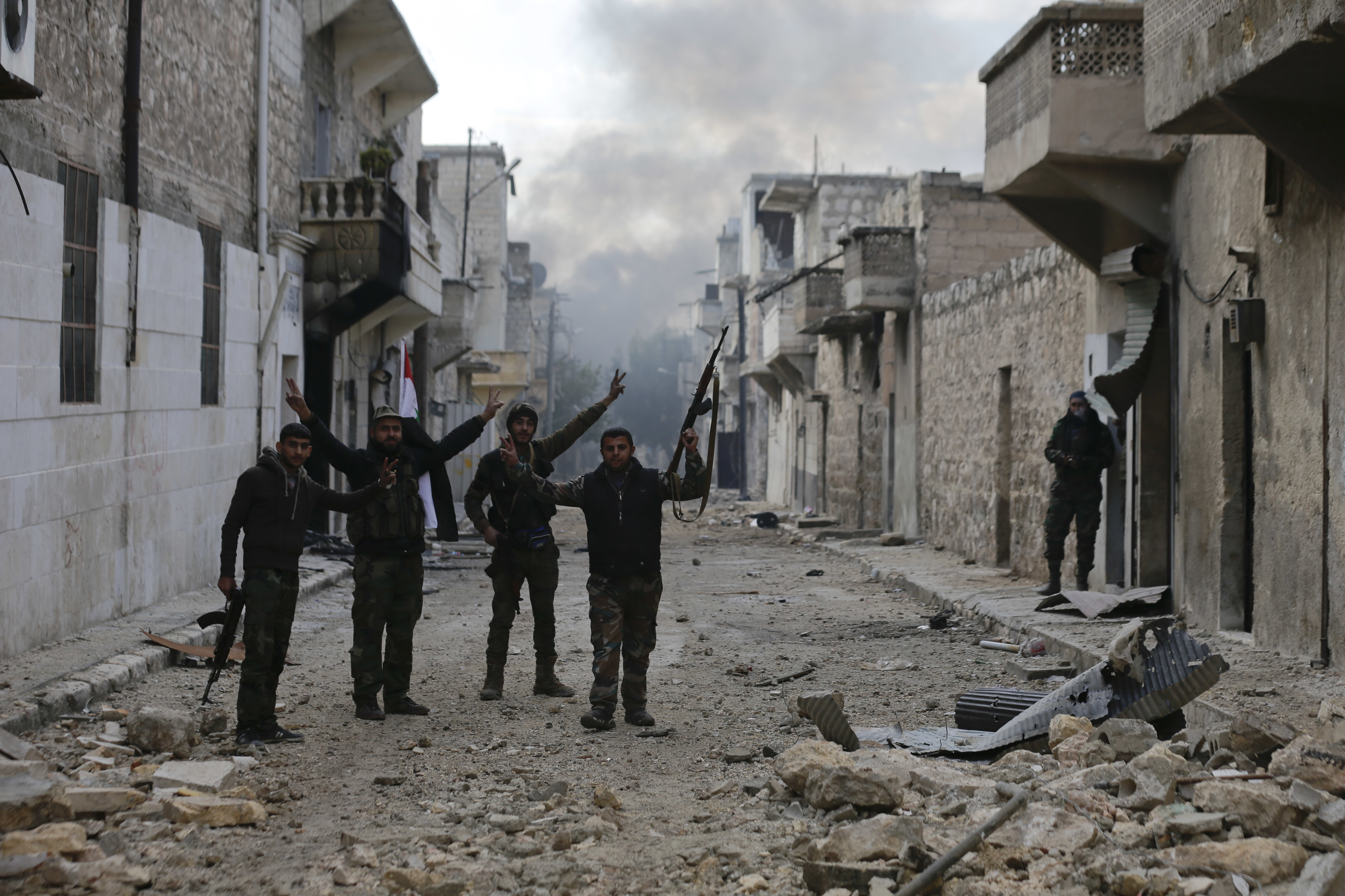Syrian army soldiers flash the V for Victory-sign