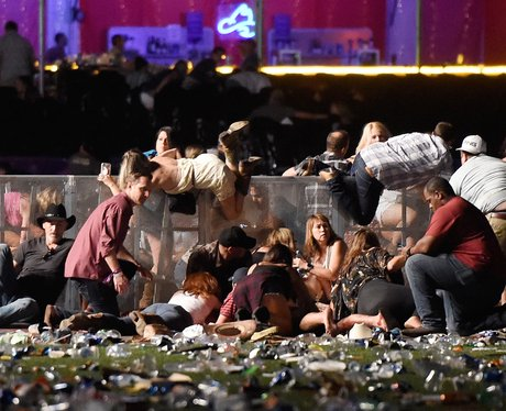 Country music fans hide as a maniac sprayed bullets at the audience in Las Vegas