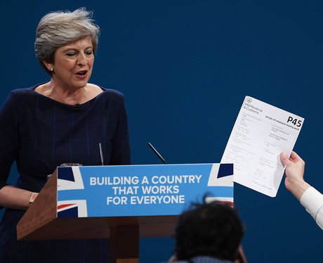 Theresa May is handed her P45 by a prankster during her Conservative Party Conference speech