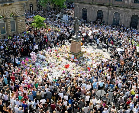 A crowd gathers in Manchester to remember the people killed in the attack at Manchester Arena
