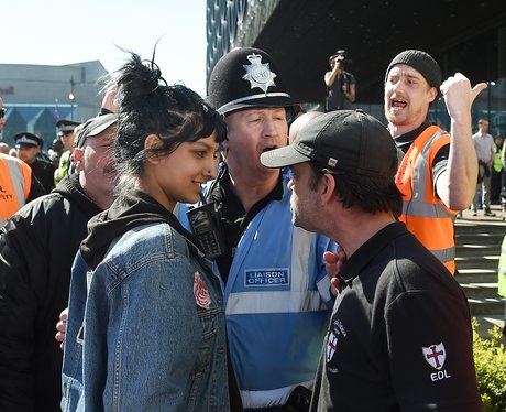 A woman smiles as she comes face to face with a right-wing protester