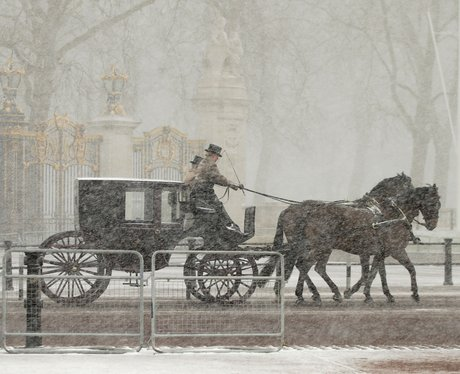 A horse and cart makes its way through the snow do