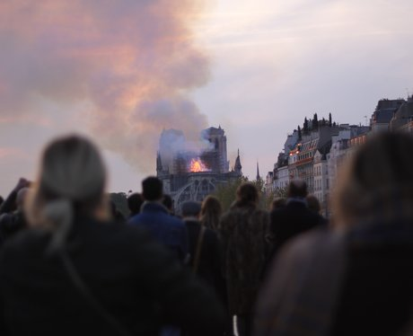 Bystanders watched in horror as smoke and flames r