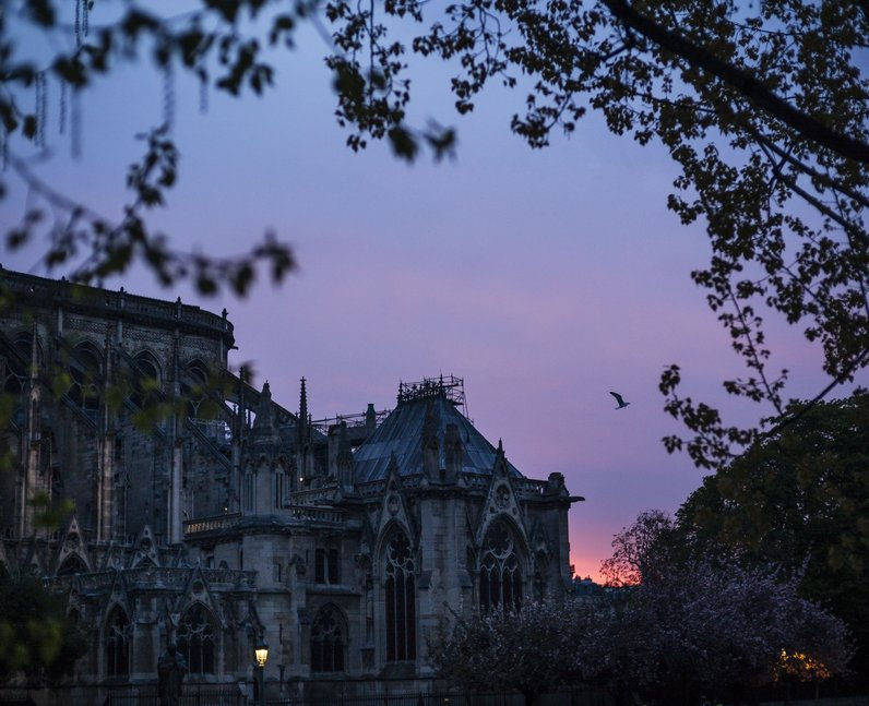 Notre Dame cathedral is seen on sunrise after the fire in Paris